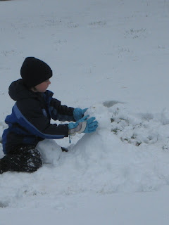 child making a snowman