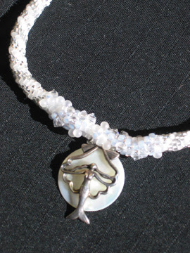 Bead crochet necklace with silver and mother of pearl mermaid pendant