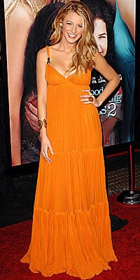 blake lively in an orange flowing gucci dress