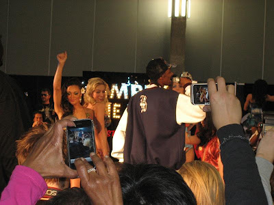 Snoop Dog performs at the Christian Audigier booth in Project Las Vegas