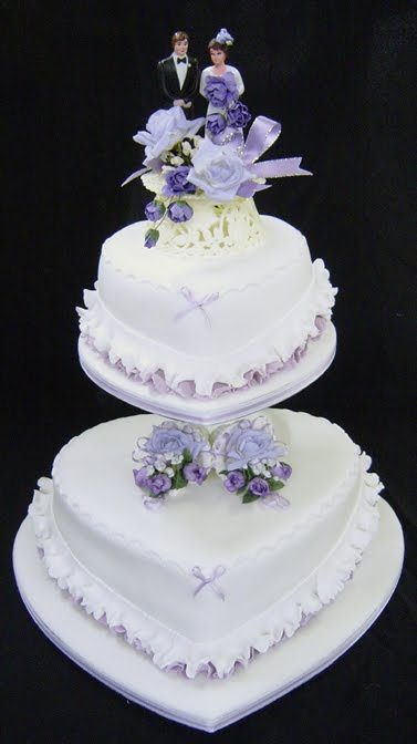two tier purple and green wedding cakes wedding cakes pictures shaped wedding cakes 21344