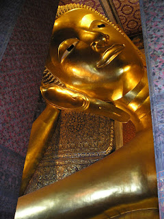 Reclining Buddha plays peekaboo