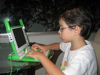 Victor playing with the OLPC