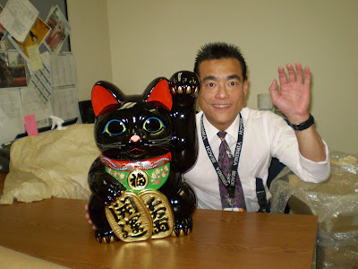 Maneki neko and one happy owner