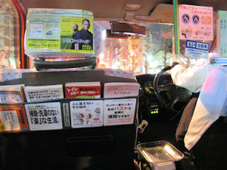 Inside a Tokyo taxi.