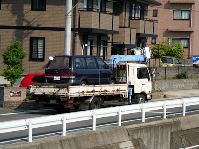 Abandoned car trucked away in Nisshin, Aichi Prefecture