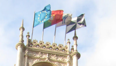Flags on Rossio Railway Station, Lisbon, Portugal.