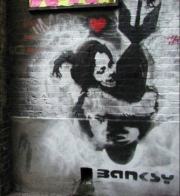 [banksy_graffiti_22.jpg]