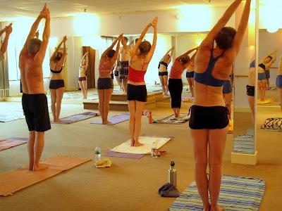 noho yoga half moon hands to feet pose