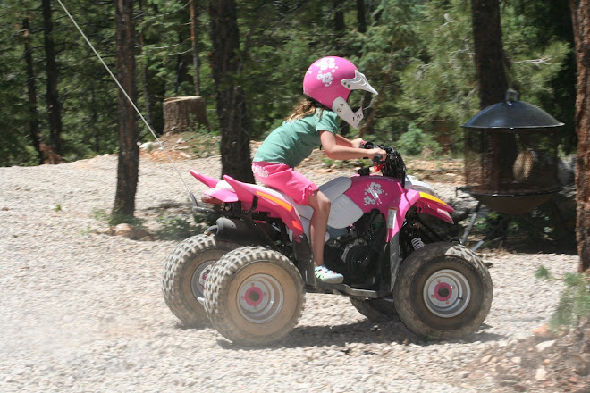 Bailey riding her quad.
