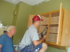 Shawn &  Frank are installing cabinets.