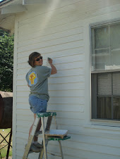 Amy...adding her artistic touch to the house!