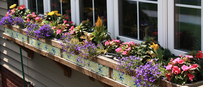 Tiled Window Boxes Along The Front Windows
