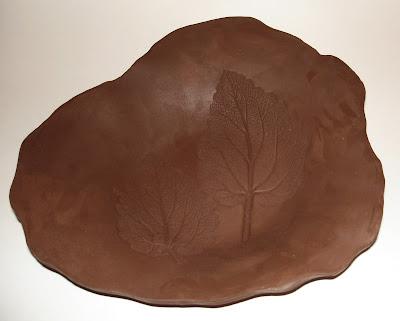 free form bowl with impressed leaf