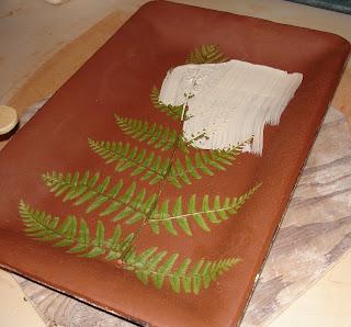 applying slip to fern platter