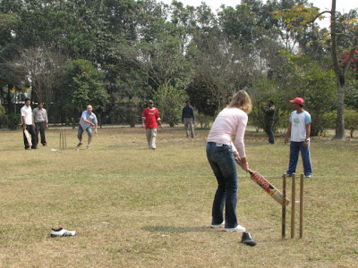 Jan's wife is batting and Jan is doing the attack job as they were in opponent teams