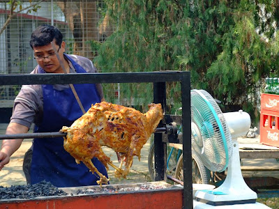 A lamb is being grilled for the lunch