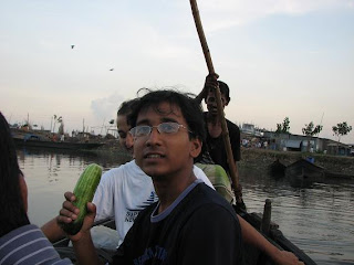 We are crossing the lake by boat. Jashim is holding salad item
