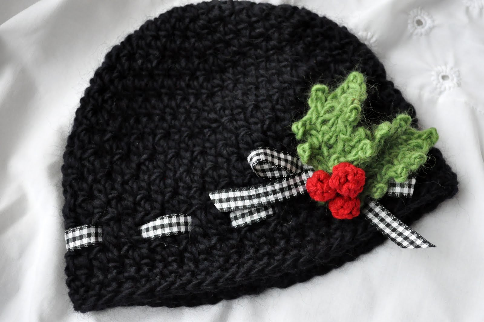 This cute hat pattern also includes the pattern for these festive holly  berries and leaves! You attach them to a clip so you can remove them and  baby can ... ad546d18e9a