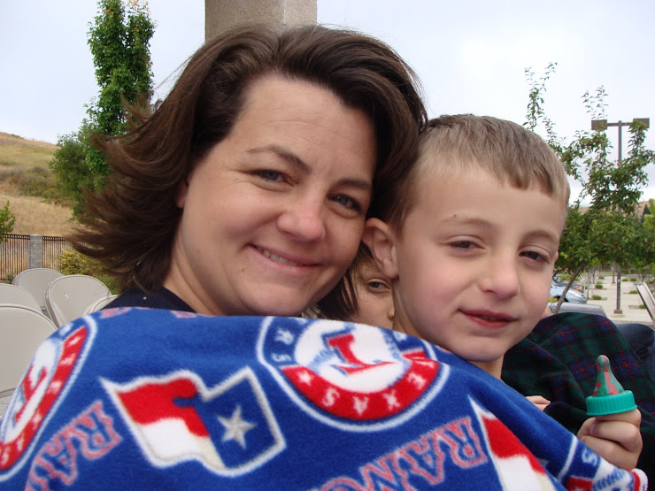 "Easton and Mommy wait for the flag ceremony. It was quite chilly!! Can you ""see""  Derek??"