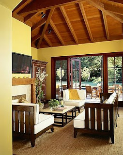 yellow paint walls and wood living room @ Chasing Davies