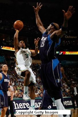 Hornets' star point guard Chris Paul shoots over Dallas' Erick Dampier. Paul finished with 32 points and a franchise record 17 assists in his team's 127-103 rout of the Mavs in Game Two.