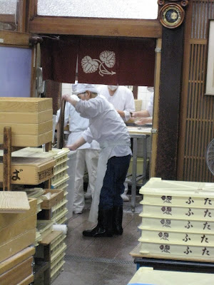 Workers busy in the back making mochi