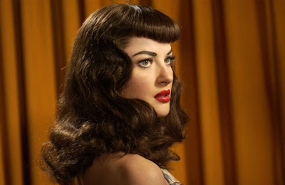 This hairstyle is an ultra retro throwback reminiscent of that famous pin-up