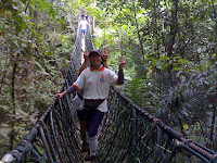 Emay leading hubby Billy across hanging bridge