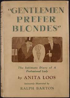 "The cover for ""Gentleman Prefer Blondes,"" featuring a simple illustration of a smiling young woman between two well-dressed men."