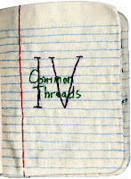 """A book of cloth pages embroider to look like notebook paper. The Roman numeral IV and the words """"Common Threads"""" are center in black and green thread."""