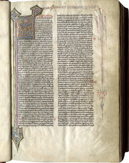 A page from a medieval manuscript featuring an elaborately illuminated initial which runs the length of the page.