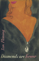 "A cover for Fleming's ""Diamonds are Forever,"" showing the jaw and décolletage of a woman, with a large diamond in her dress's neckline."