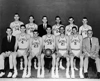 A black and white basketball team photograph.