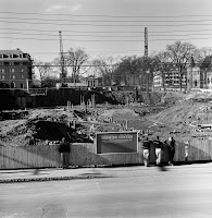 A black and white construction site photograph.