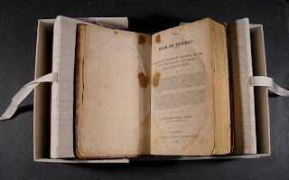 The Book of Mormon, open inside its case.