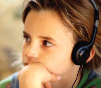 NAMC montessori classroom observing sensory processing disorder girl with headphones