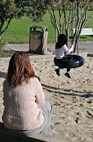 NAMC montessori education for children with sensory processing disorder girl on tire swing