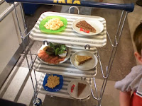 LB loved pushing the tray cart