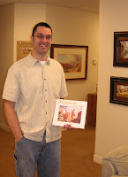 Architect and artist Dan Cross holding Roland Lee's Mukuntuweap book