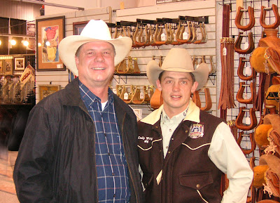 Photo of Saddle Bronc cowboy Cody Wright with artist Roland Lee at the 2007 National Finals Rodeo.