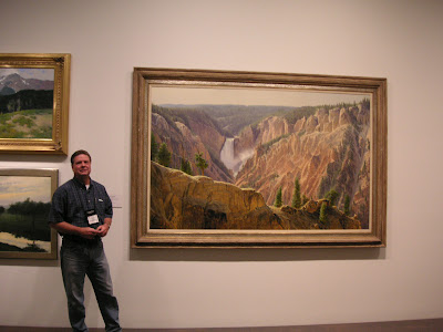 Roland Lee in front of Wilson Hurley painting at the Denver Art Museum