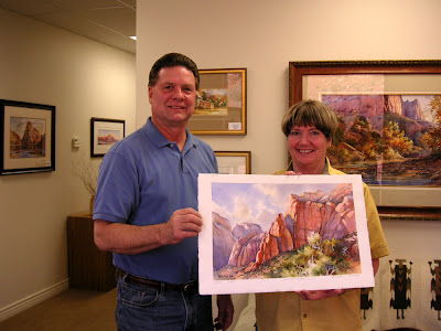 Roland Lee with collector Leslie Layton and her painting of Zion National Park, Sandstone Towers
