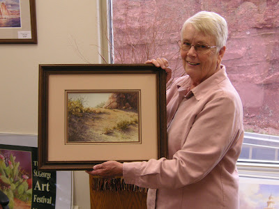 Art collector Joyce Oveson with Roland Lee watercolor painting