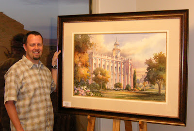 Art collector Blake Arnold with his purchased painting Temple Glow, a watercolor painting of the St. George LDS Temple by Roland Lee