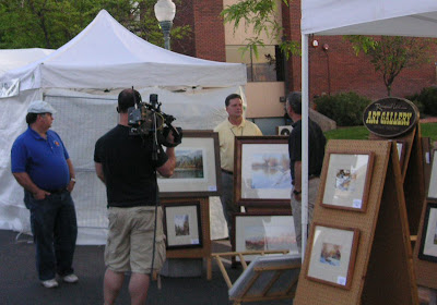 KUTV Television news crew doing interview with artist Roland Lee at the St. George ARt Festival