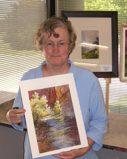 Tina Davis, art collector with Roland Lee painting