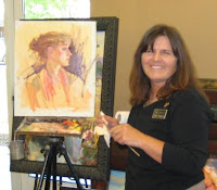 Artist Julie Rogers does an oil portrait