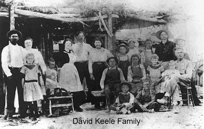 The old Samuel Keele Ranch between Panaca and Caliente, Nevada, taken in 1912. This old ranch was a favorite meeting place for the family in the summertime. These are the descendents of David Keele, son of Samuel Keele: (Left to right) Back row, standing: John Raymond Lee, husband of Annie Keele and son of John Nelson Lee; Annie Keele Lee, daughter of David Keele; Myrtle Lee, daughter of Annie; Quincy Keele, son of David; Roxa Edwards Keele, wife of Quincy; James Harold Lee, son of Annie; Leah Burdetta Lee, daughter of Annie; Hazel, daughter of Eathel Keele Lee, daughter of David; Frances Marion Keele, son of David; Howard Geary Keele, son of David. First row: Melba Lee, daughter of Annie; Lester Nelson Lee, son of Annie (standing on chair). Sitting on bench: Jesse Raymond, son of Annie; Irita Keele, daughter of David; Estella Lee, daughter of Annie; Margaretta, daughter of Annie; David Keele, son of Samuel. Sitting on ground: Guy Willis Lee, son of Annie; Orval Keele, son of David.