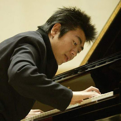 He is a hot artist on classical music who has modern spiky hairstyle.